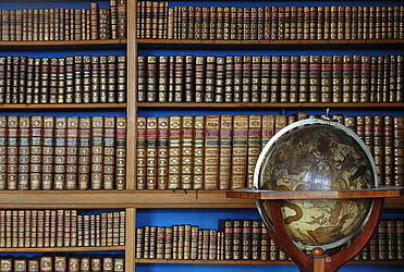 A part of Charles II August, Duke of Zweibrücken's court library; in the foreground, a celestial globe by G. and L. Valk from 1715 | SBB