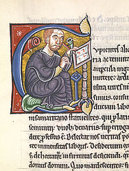 Historicising initial showing Peter Lombard at his writing desk. Northern France, before 1159 | SBB, Msc.Patr.120, fol. 3r